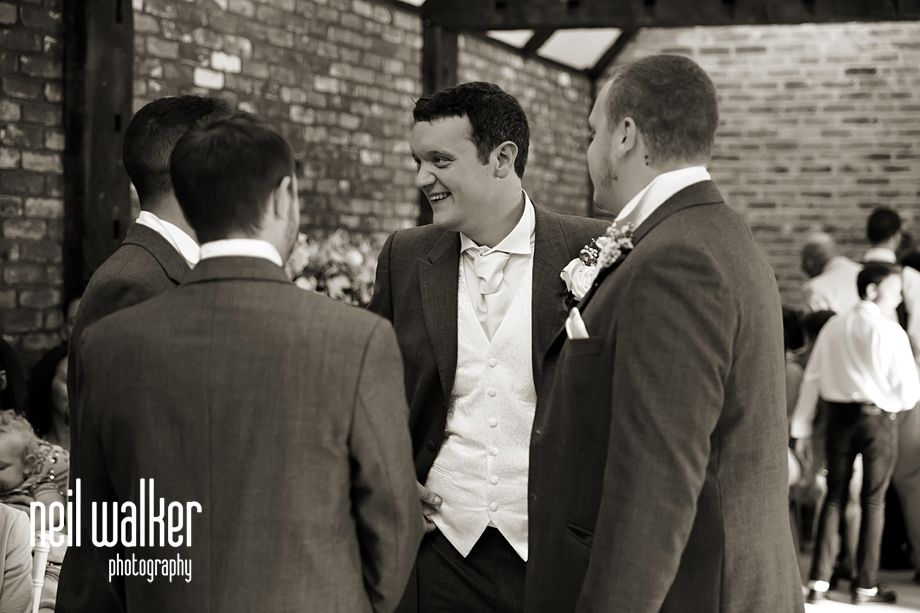 the groom talking to his ushers