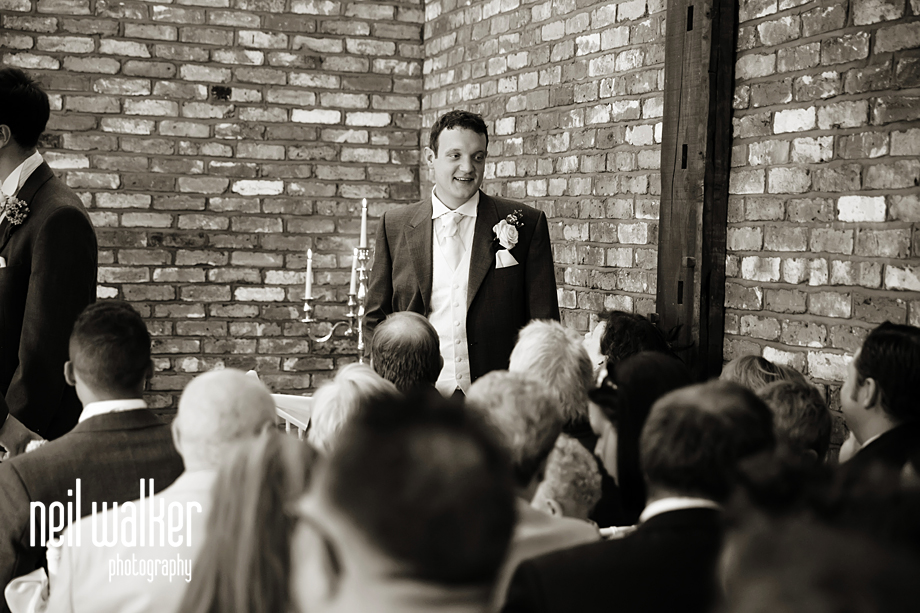 the groom talking to a guest