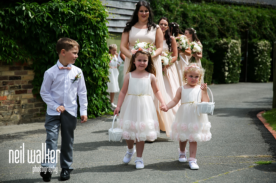 the flower girls walking to the ceremony