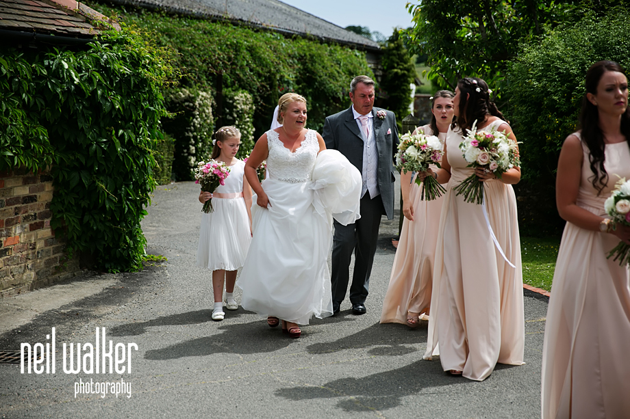 the bridal party walking to the ceremony