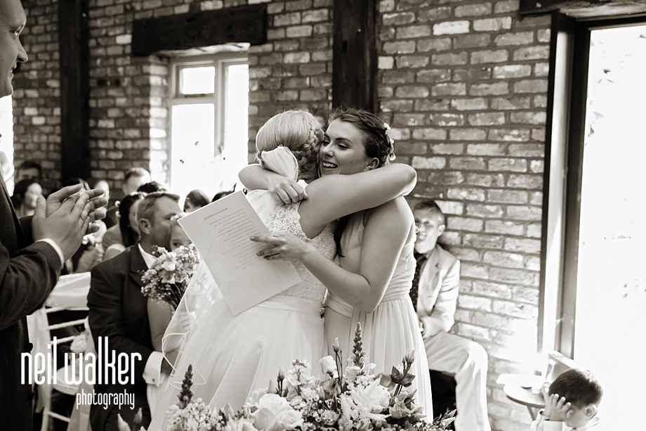 the bride & bridesmaid embrace