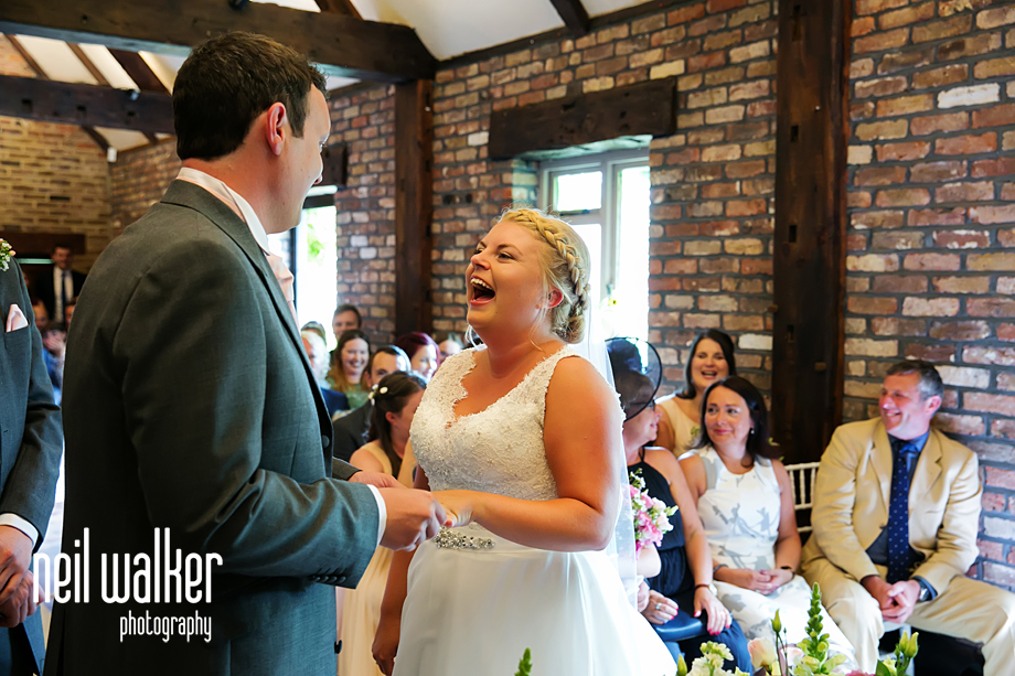 the bride & groom smile at each other