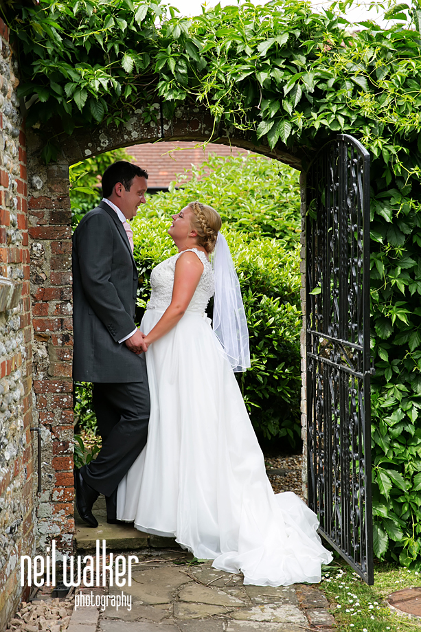 the bride & groom in a doorway