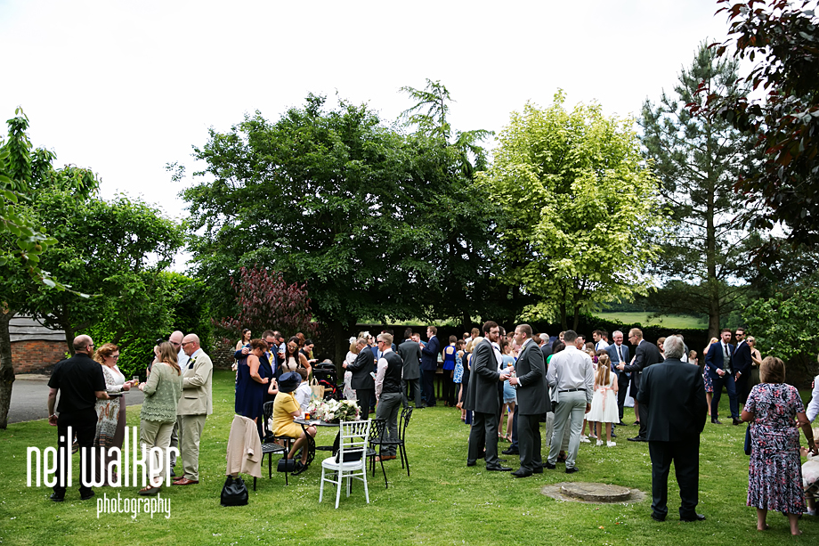 guests on the lawn enjoying drinks