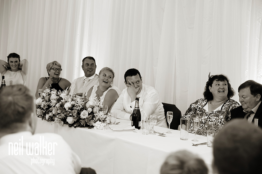 the groom laughing at the speech