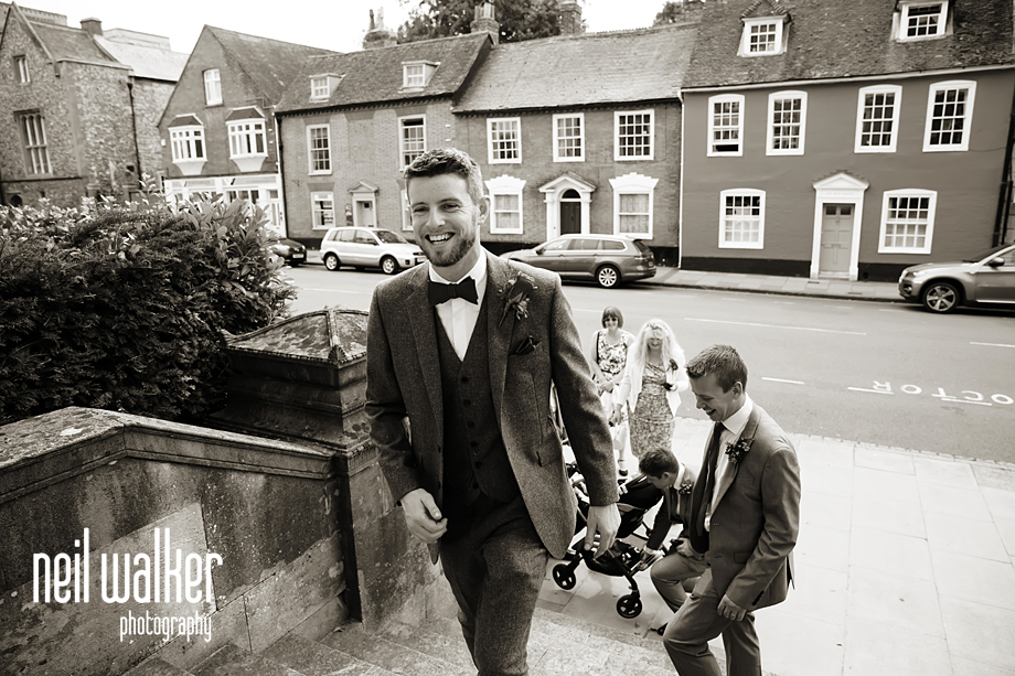 the groom walking in to the venue