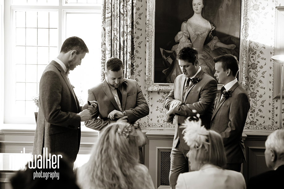 the groomsmen checking their watches