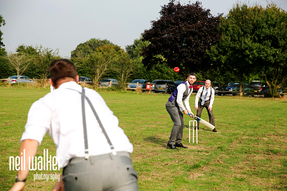 the groom playing cricket