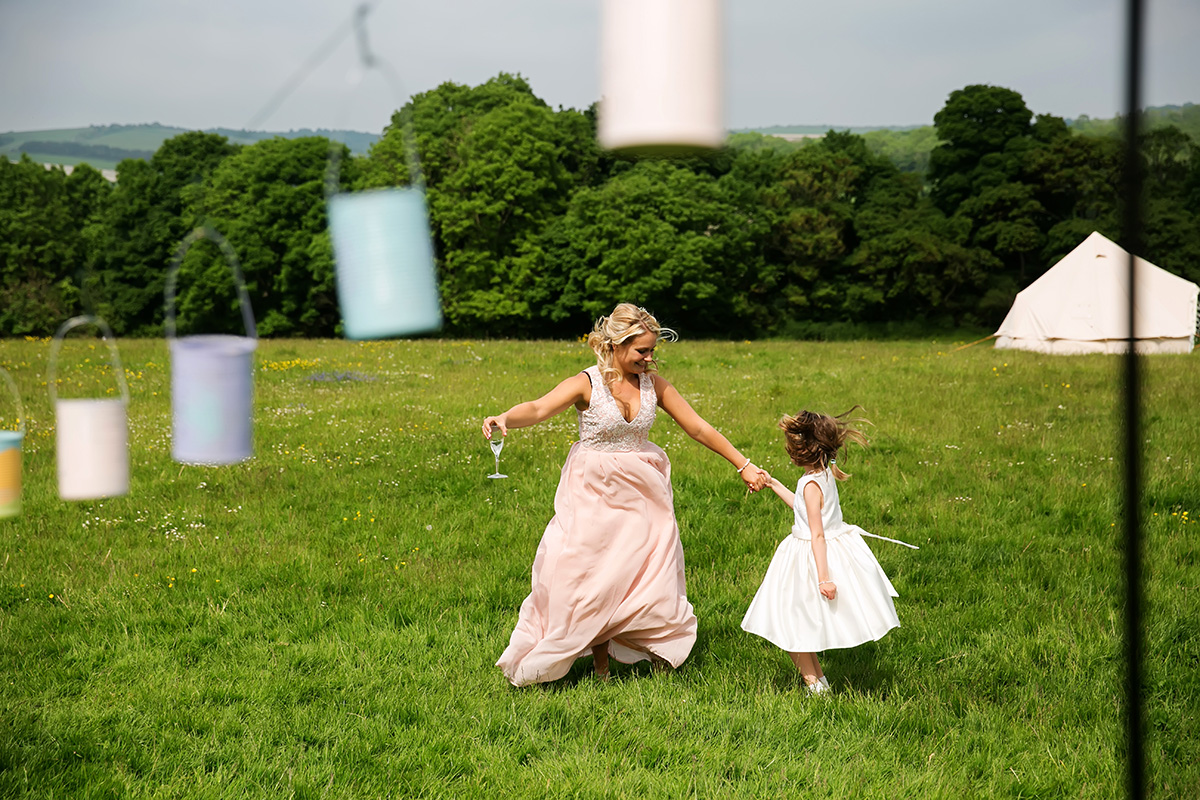 bridesmaid dancing with flower girl