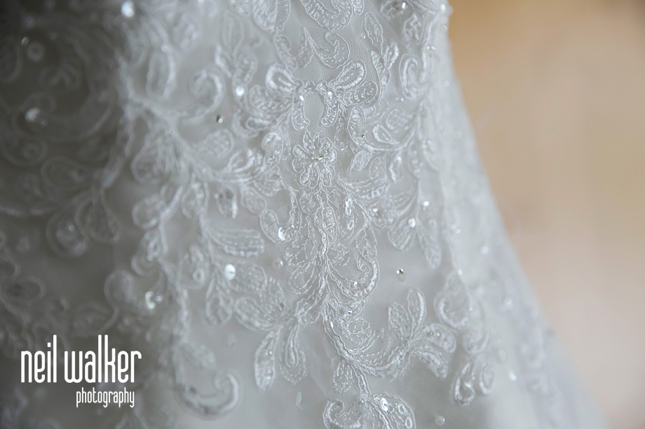 a close up of the bride's dress