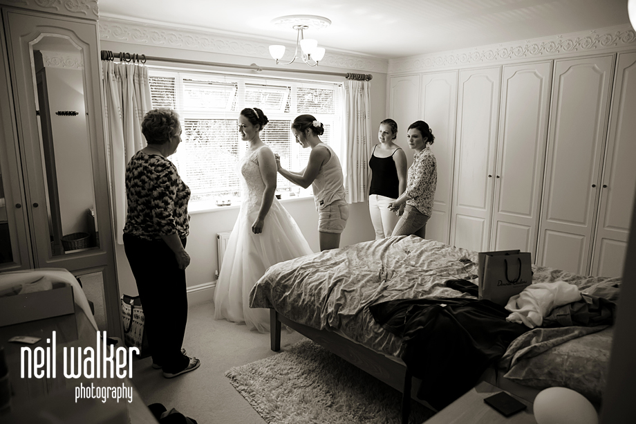 bridesmaids talking while the bride dresses