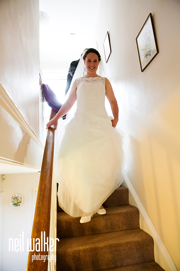 the bride coming down the stairs