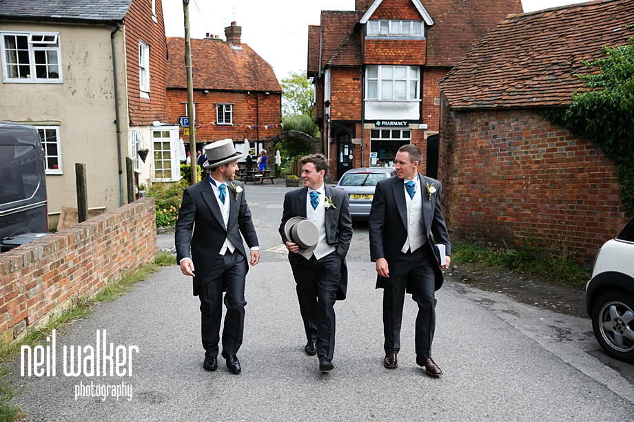 the groomsmen walking to the church