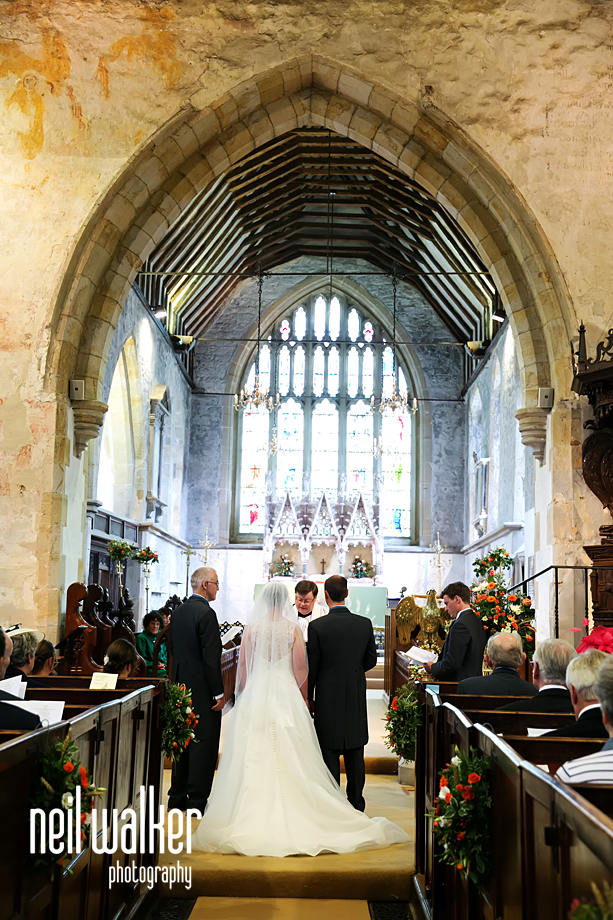 the bride & groom & the interior of the church