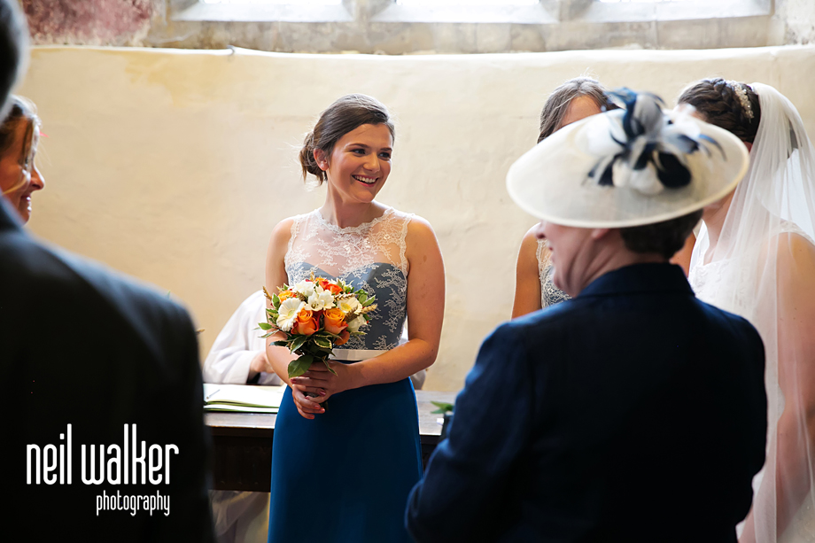 a bridesmaid laughing