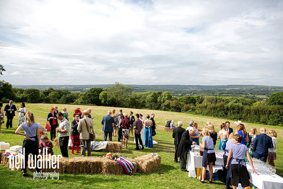 wedding guests in a field in East Sussex