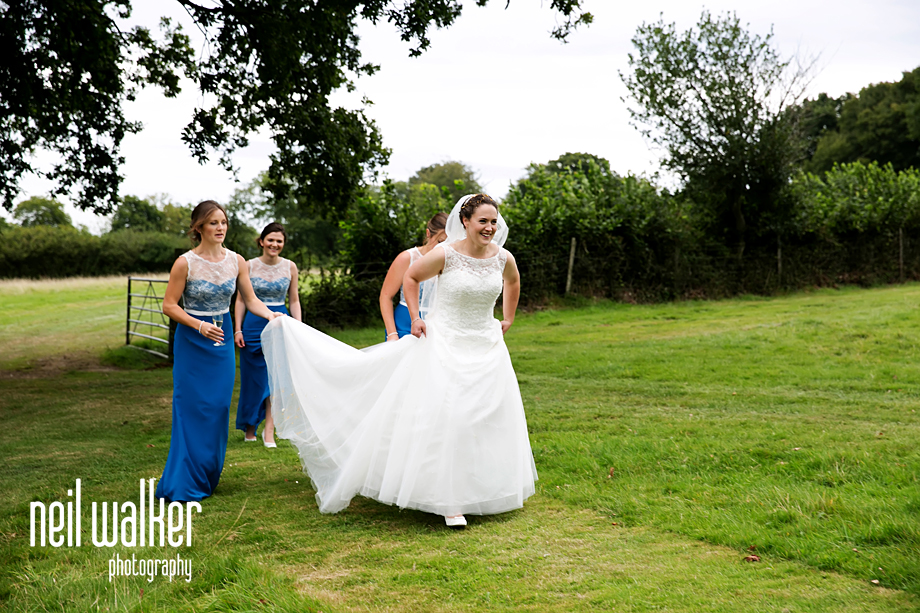bride walking across a field