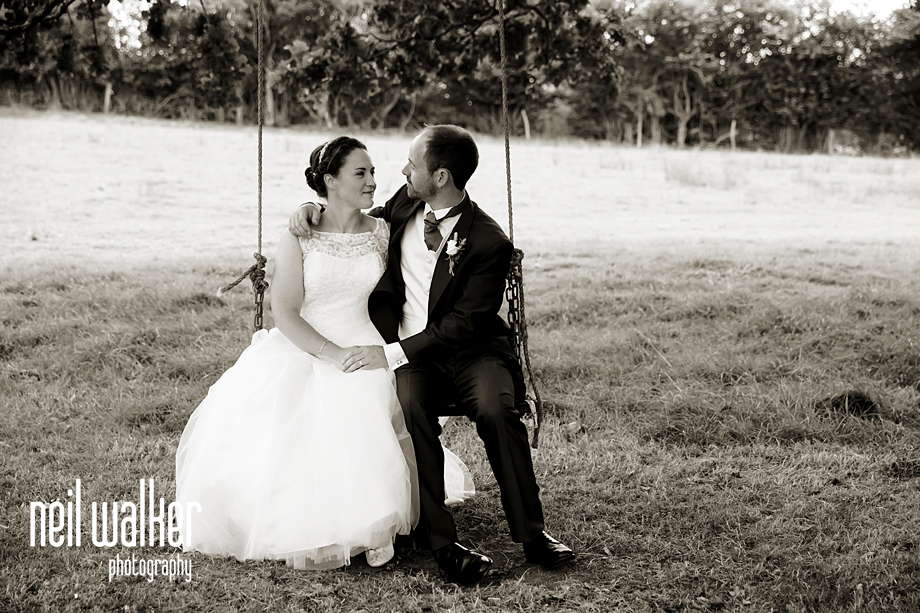 bride & groom on a swing