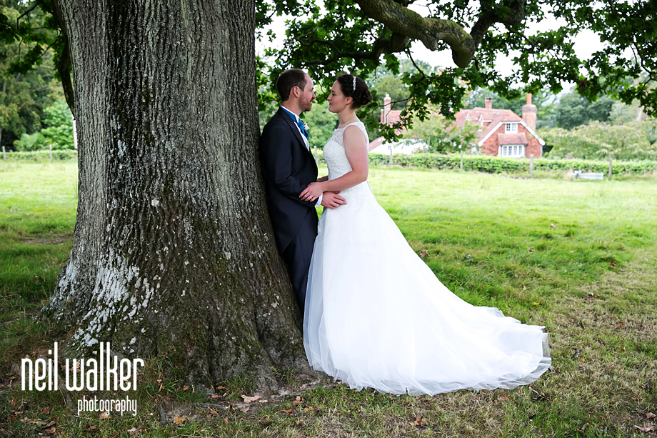 bride & groom by a tree