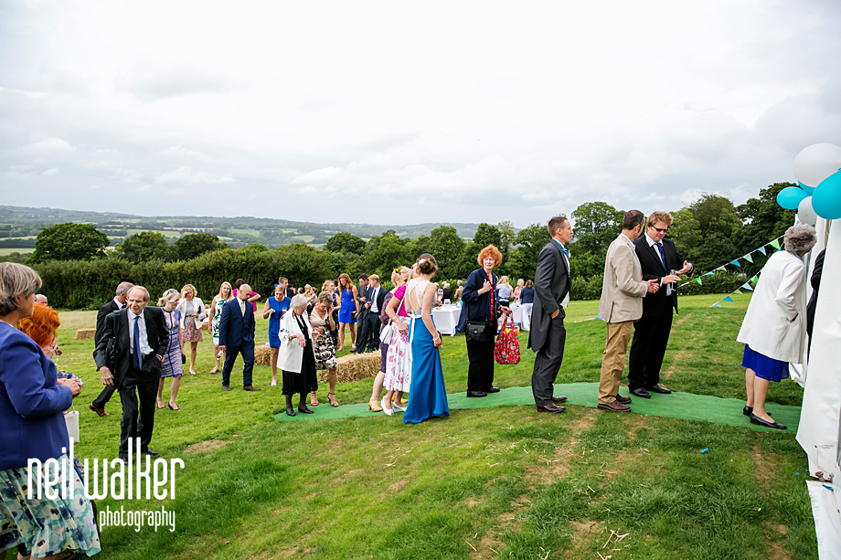 wedding guests entering the marquee