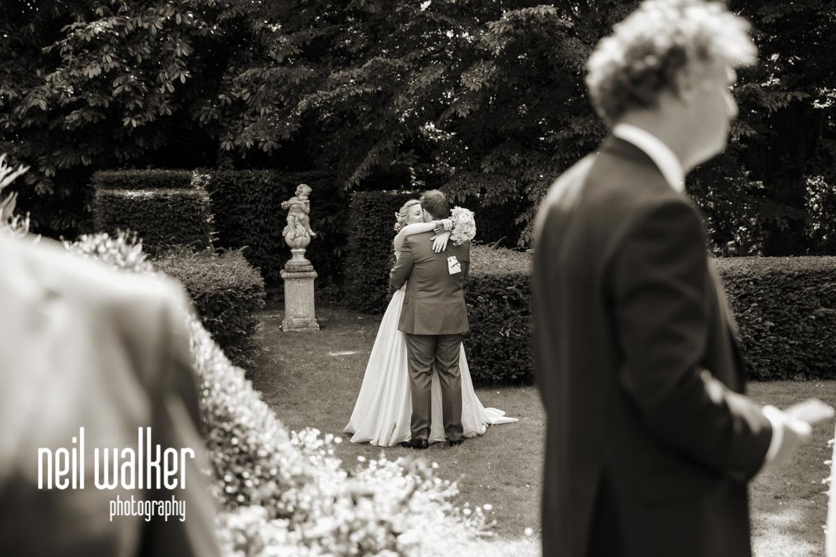 bride & groom having a hug on their own