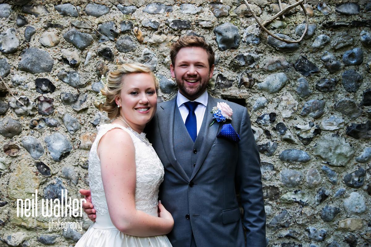 bride & groom posing for a photo