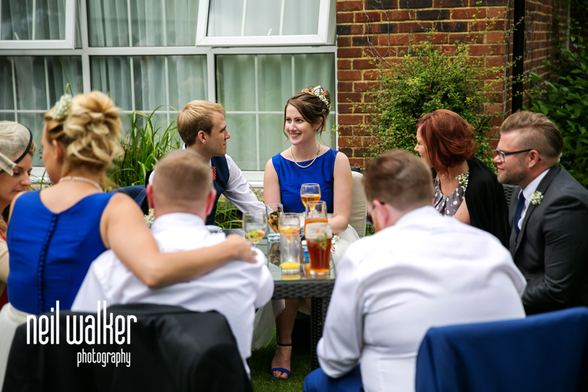 a bridesmaid talking with guests