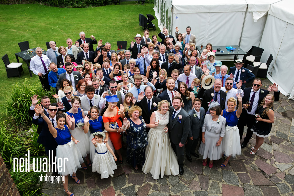 a formal photo of all the guests