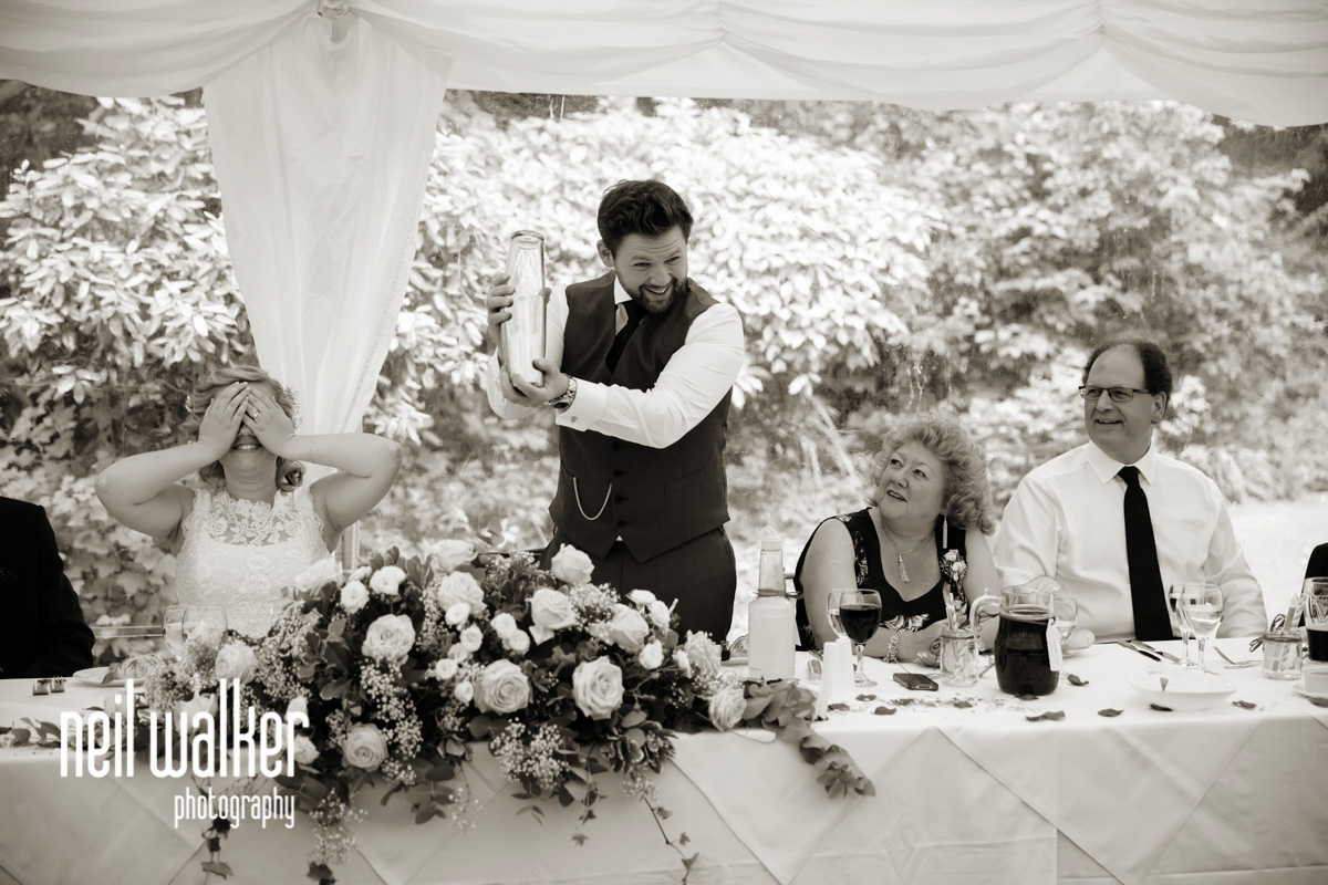 groom shaking a cocktail