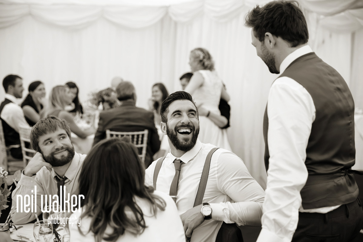 a guest talking to the groom