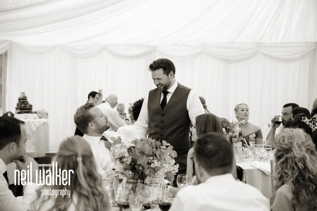 groom talking to another guest