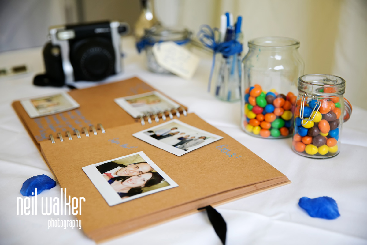 a photobook with polaroids in