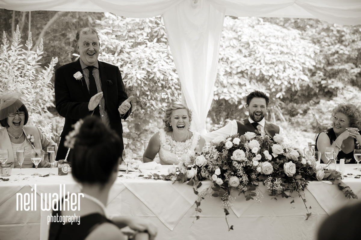 bride laughing at the pseech