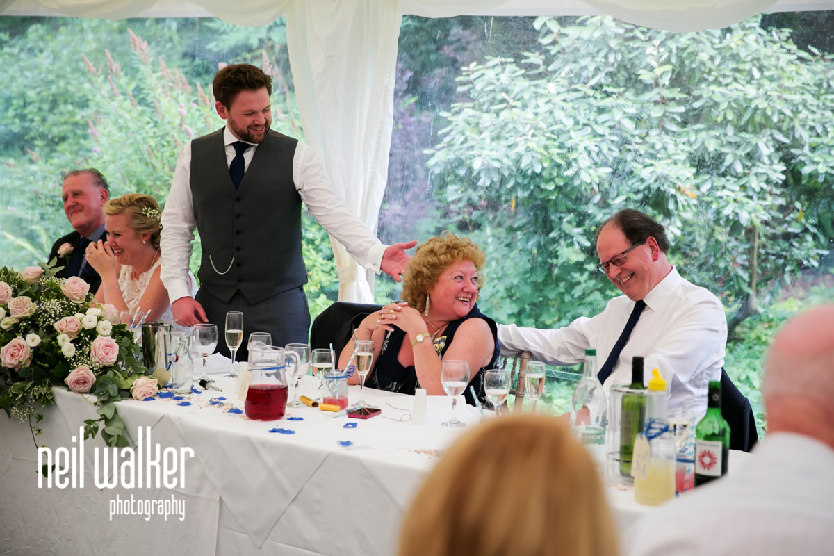 mother of the groom laughing at his speech