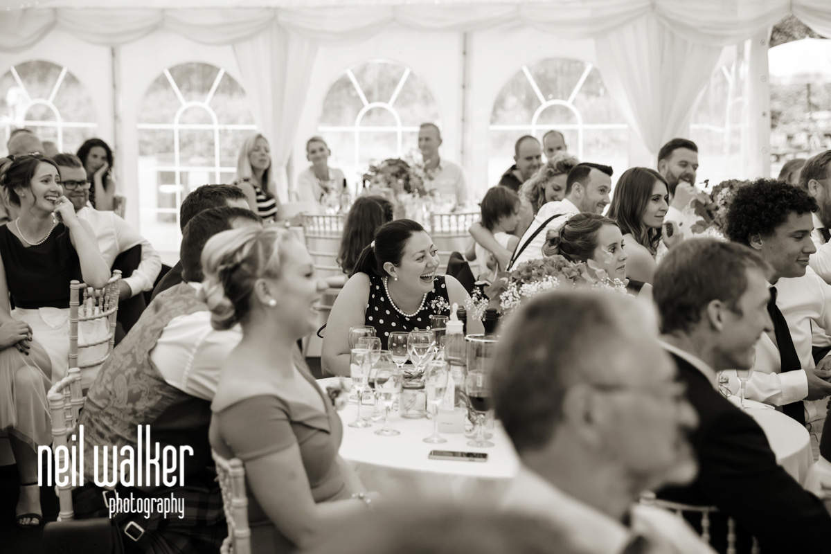 bridesmaid laughing at the best man's speech