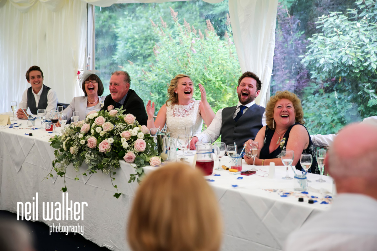 bride laughing at the best man's speech