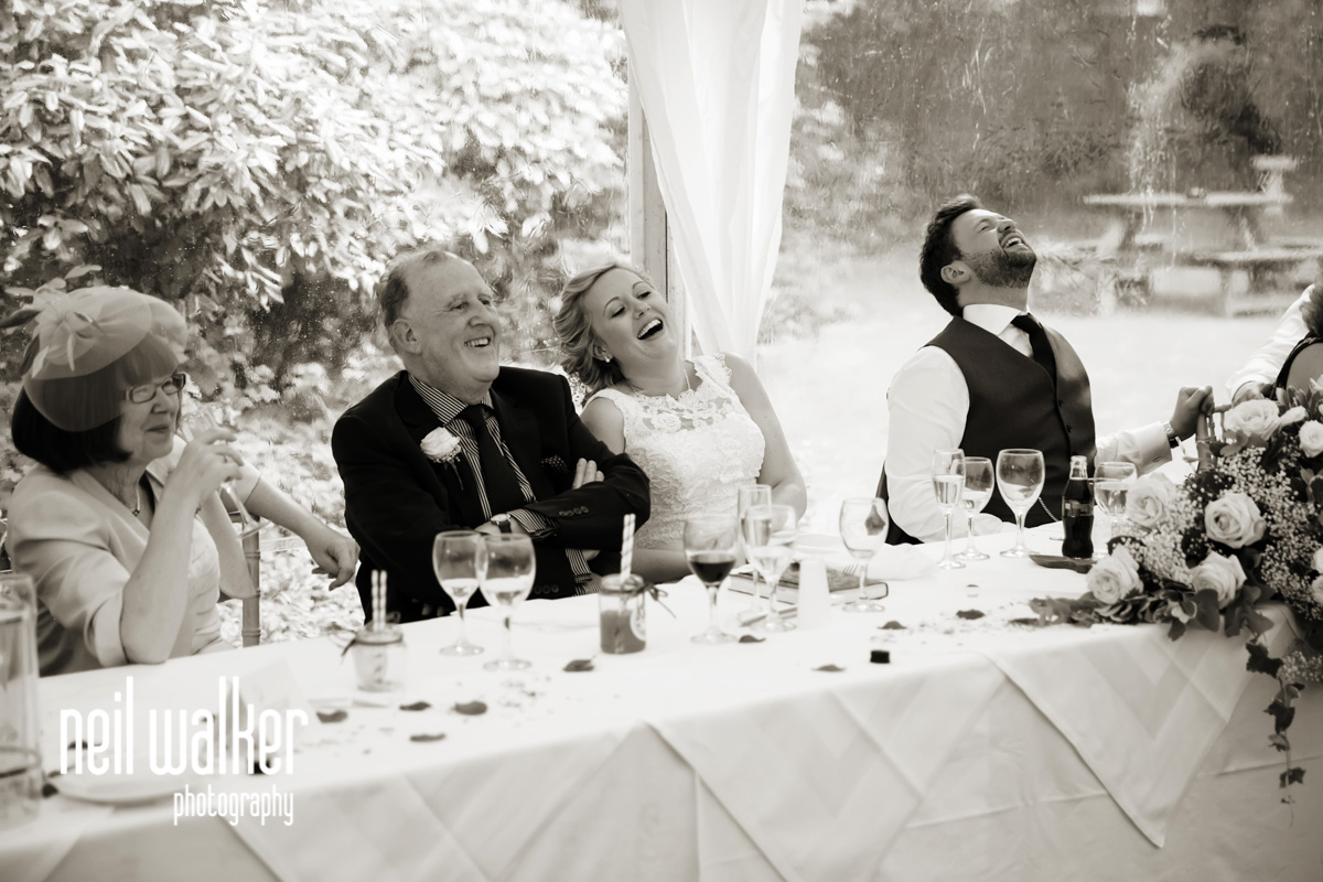 bride & groom laughing together