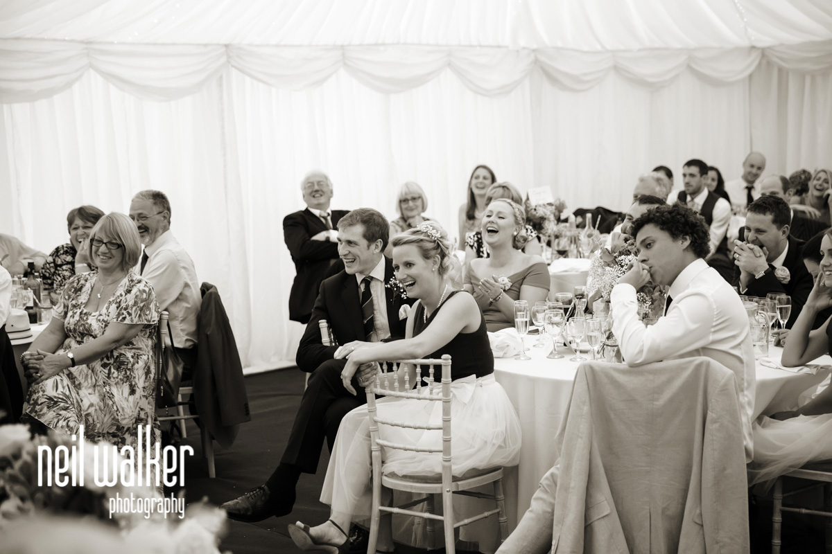 guests listening to the best man's speech