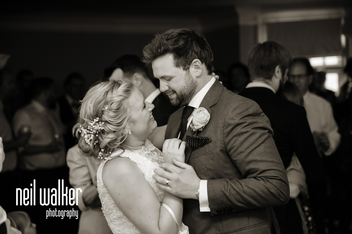 bride & groom looking at each other during the first dance