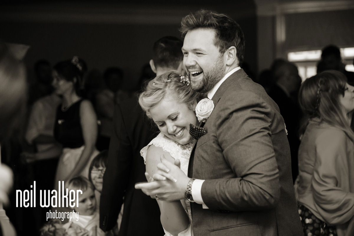 groom laughing during the first dance