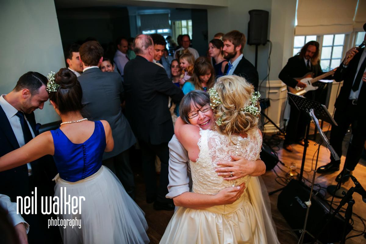 bride hugging her mother