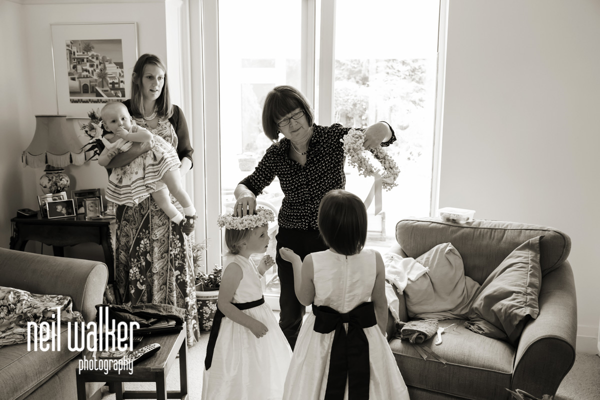 mother of the bride giving the flower girls their bouquets