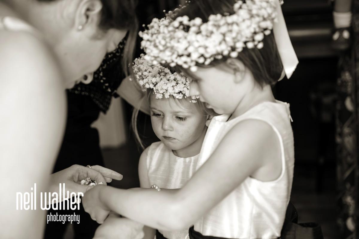 flower girls putting on their bracelets