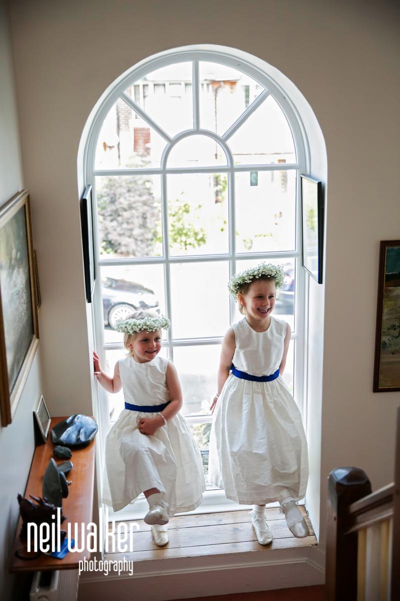the flower girls by a window
