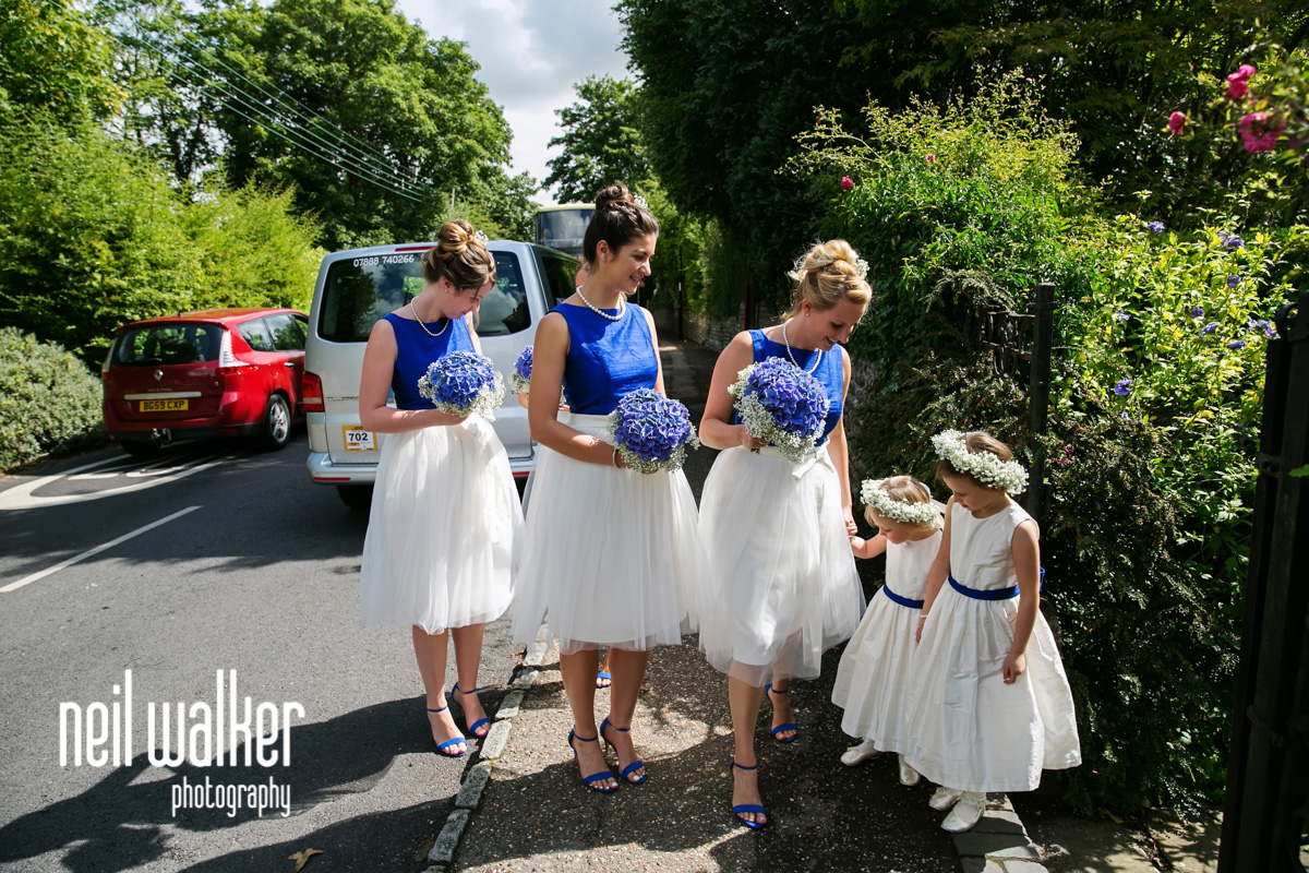 flower girls & bridesmaids outside St Mary's