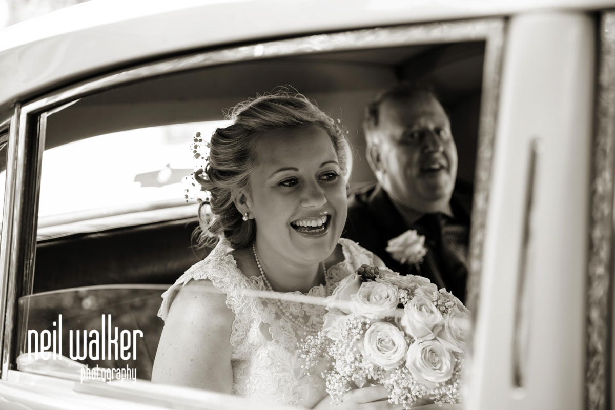 the bride through the window of the bridal car