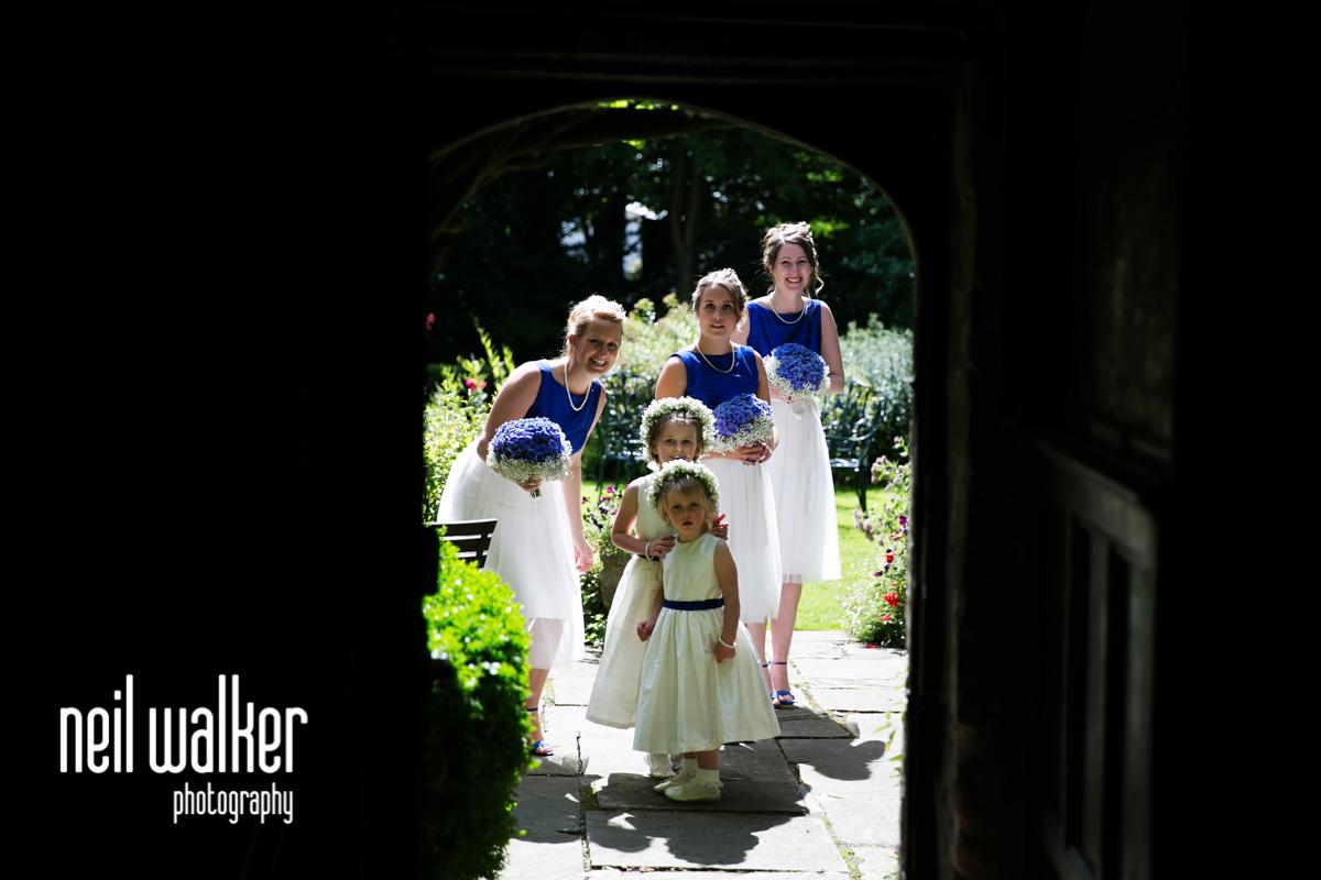 bridesmaids through a doorway