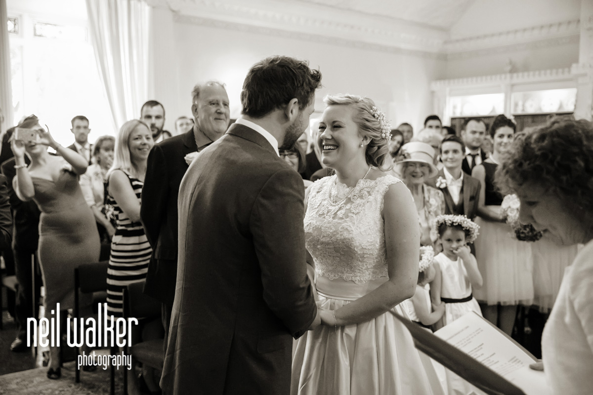 bride & groom smiling at each other as they get married