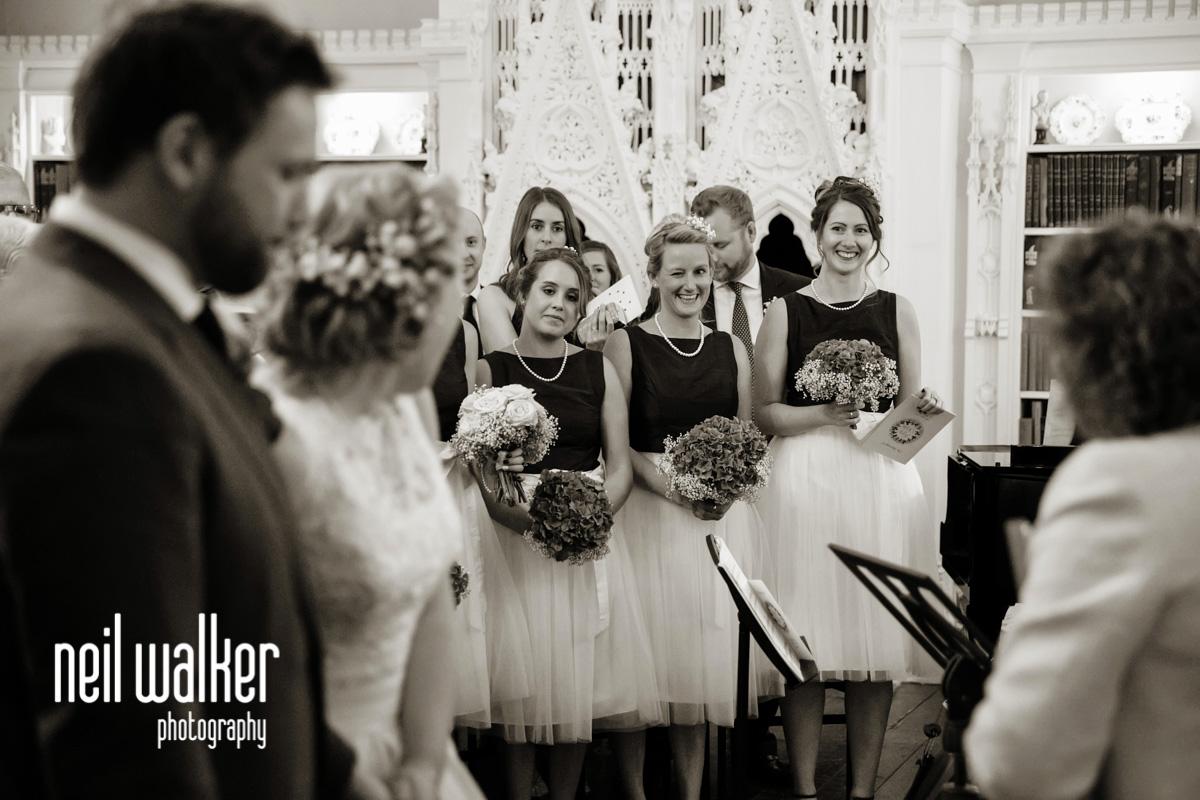 bridesmaid winking at the bride