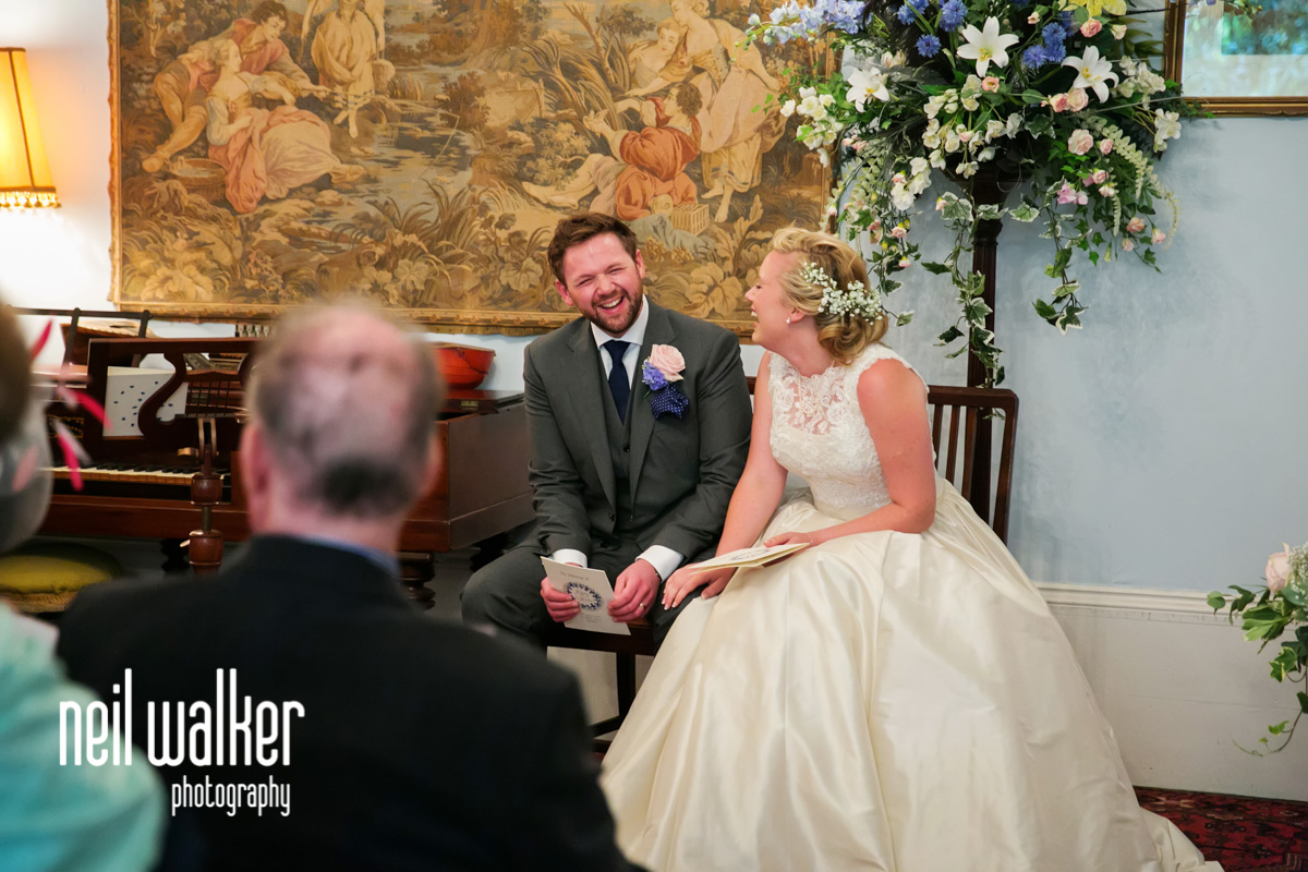bride & groom sitting & laughing